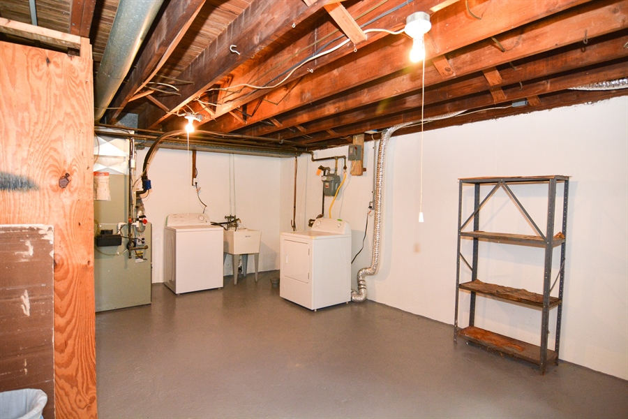 Real Estate Photography - 178 Wiltshire Rd, Claymont, DE, 19703 - Lots of storage in waterproofed Basement