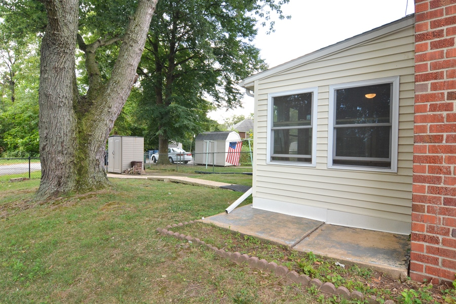 Real Estate Photography - 178 Wiltshire Rd, Claymont, DE, 19703 - Side Patio, rear Patio, storage Shed