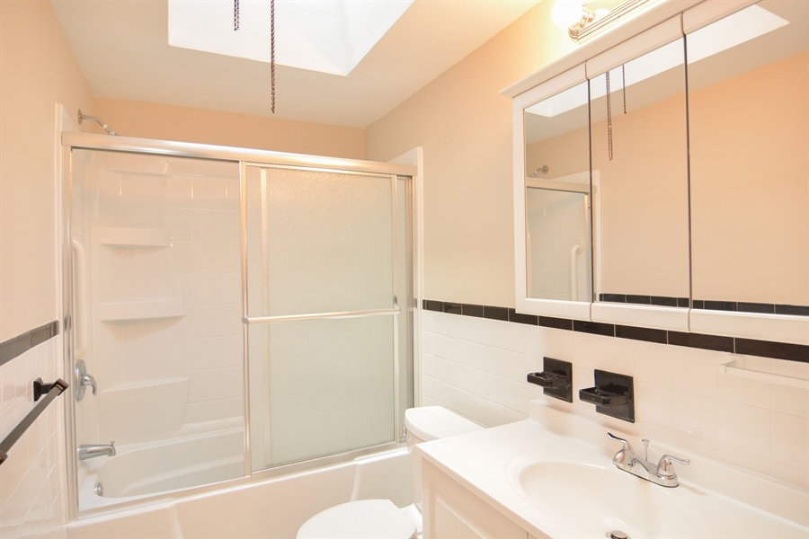 Real Estate Photography - 178 Wiltshire Rd, Claymont, DE, 19703 - Updated 2nd flr hall Bath with skylight