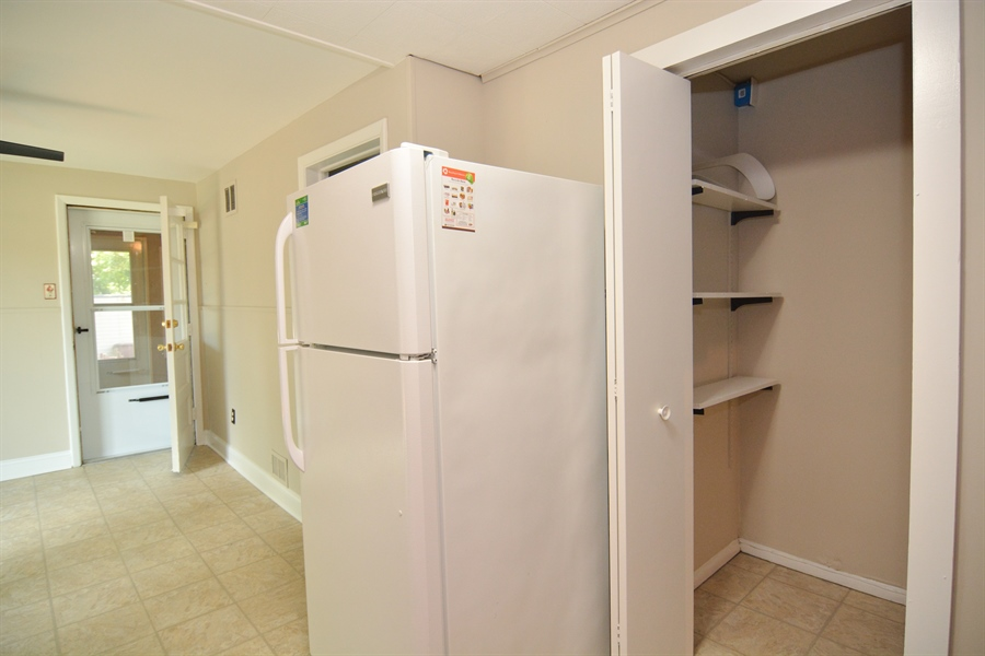 Real Estate Photography - 178 Wiltshire Rd, Claymont, DE, 19703 - Pantry storage + several steps to Basement level