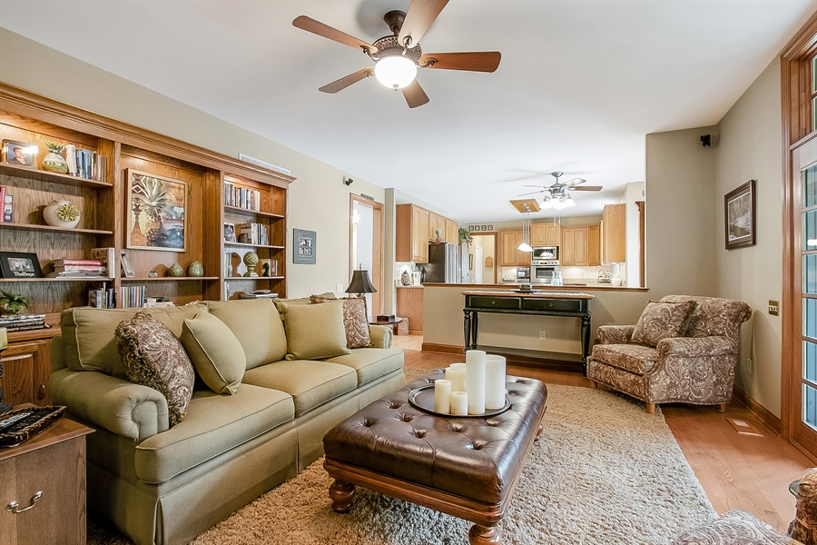 Real Estate Photography - 525 Ridgeview Dr, Hockessin, DE, 19707 - Family Room with Hardwood Floors Open to Kitchen