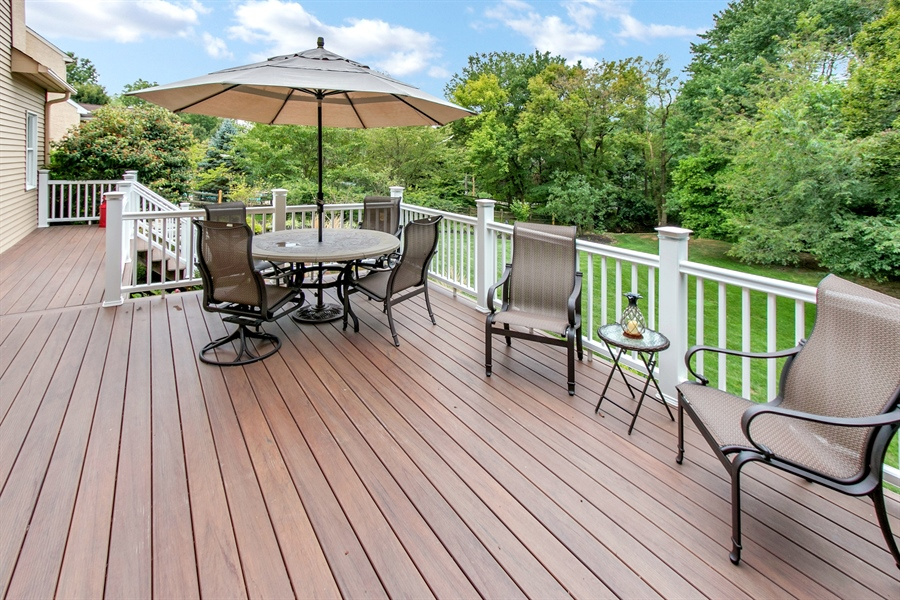 Real Estate Photography - 525 Ridgeview Dr, Hockessin, DE, 19707 - Spacious Deck w/ Lighted Posts...Stunning at Night