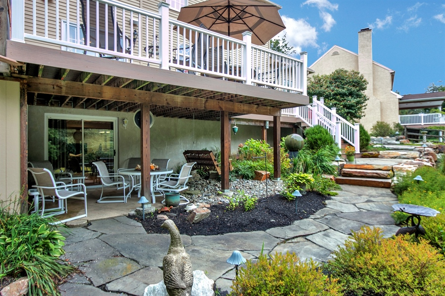 Real Estate Photography - 525 Ridgeview Dr, Hockessin, DE, 19707 - Beautiful View of the Lower Level Patio & Walkway