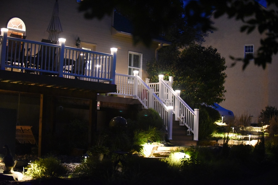 Real Estate Photography - 525 Ridgeview Dr, Hockessin, DE, 19707 - View of Deck at Night With Lighted Posts