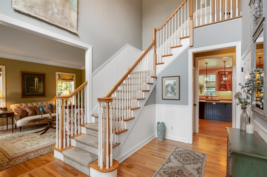 Real Estate Photography - 784 Shavertown Rd, Garnet Valley, PA, 19060 - Elegant two-story entryway with gleaming hardwoods