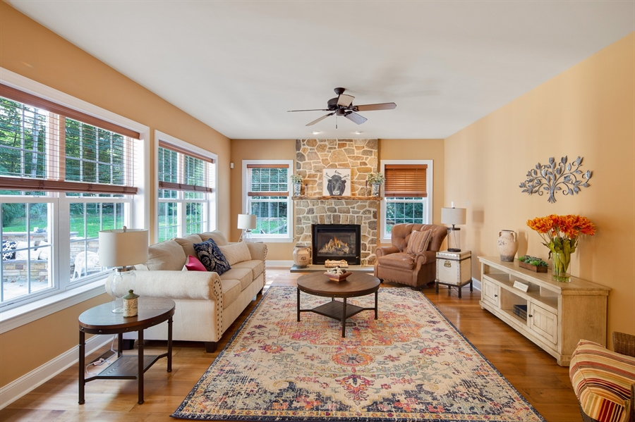Real Estate Photography - 784 Shavertown Rd, Garnet Valley, PA, 19060 - Warm & elegant family room with stone fireplace