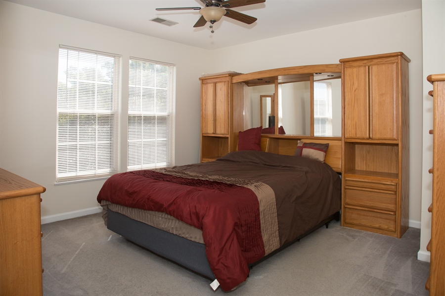Real Estate Photography - 11 Wisteria Dr, Newark, DE, 19702 - Master bedroom w/ceiling fan, entry to shared bath