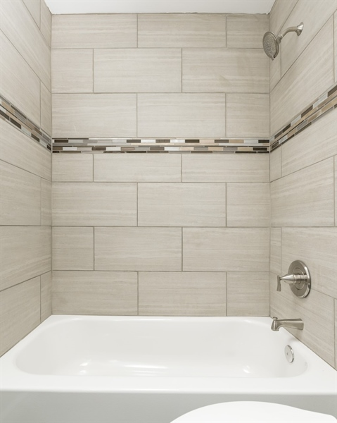 Real Estate Photography - 3038 W Court Ave, Claymont, DE, 19703 - Tiled Shower
