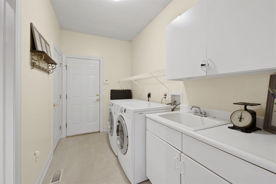 Real Estate Photography - 30 Fall Brooke Rd, Newark, DE, 19711 - Main Floor Laundry with Garage Access
