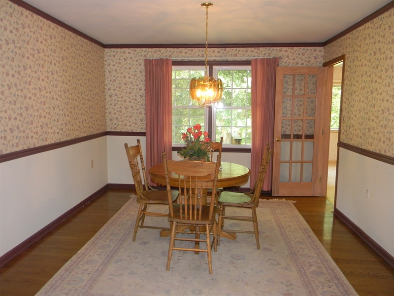 Real Estate Photography - 210 Atlanta Ct, Elkton, MD, 21921 - Dining Room with Chair Rail & Crown Molding
