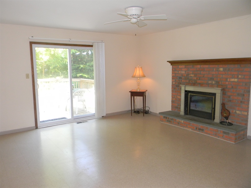 Real Estate Photography - 210 Atlanta Ct, Elkton, MD, 21921 - Family Room w/ Fire Place, Slider to Deck