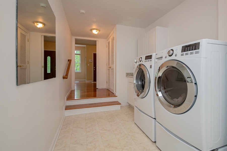 Real Estate Photography - 204 N Star Rd, Newark, DE, 19711 - Main Laundry that Conects to In-law Suite