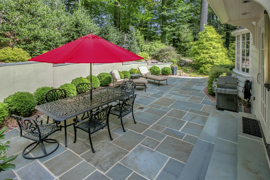 Real Estate Photography - 300 Kennett Pike, Chadds Ford, PA, 19317 - Rear Slate Patio with Lush Landscaping