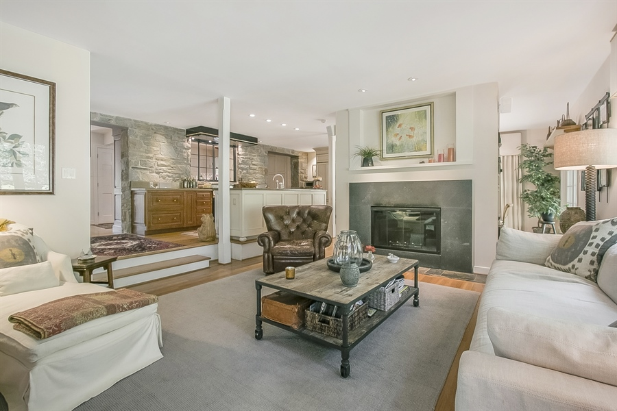 Real Estate Photography - 300 Kennett Pike, Chadds Ford, PA, 19317 - Sunken Family Room with Wood Burning Fireplace
