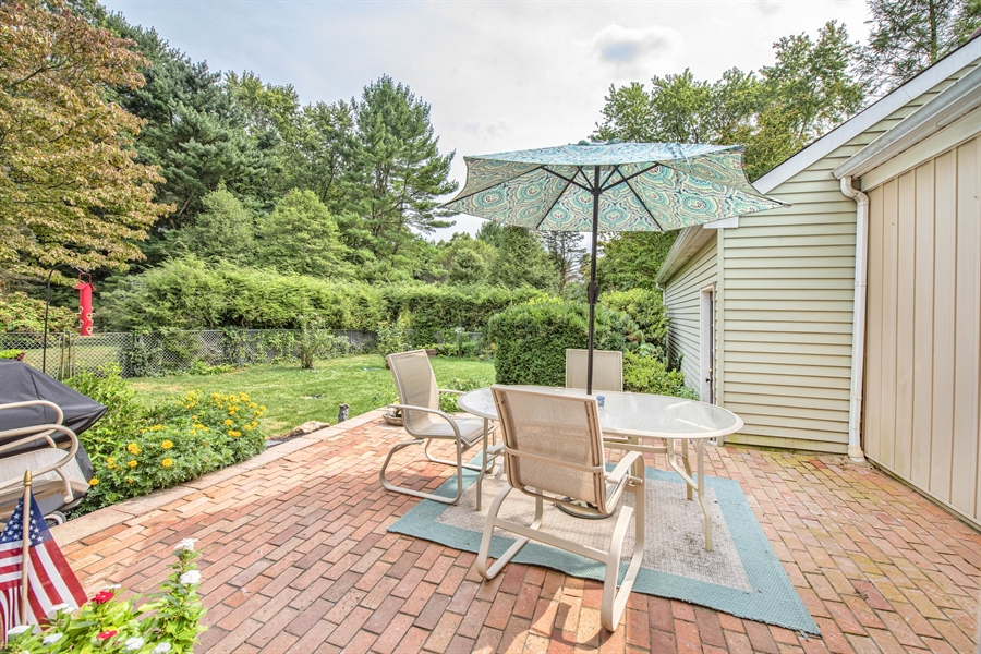 Real Estate Photography - 700 Fawn Rd, Newark, DE, 19711 - view from kitchen toward patio and yard