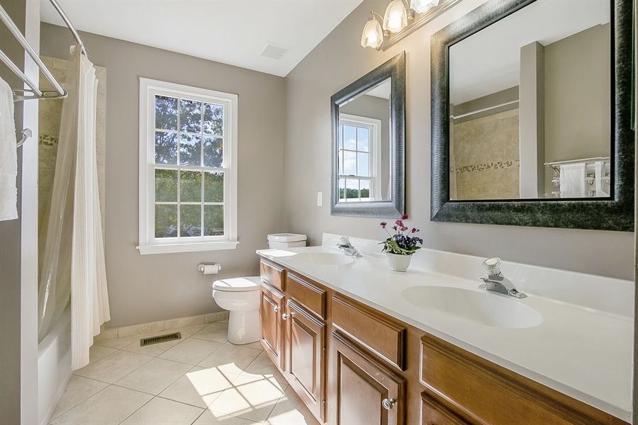 Real Estate Photography - 5 Grosbeak Ln, Newark, DE, 19711 - Upgraded Hall Bath With Framed Mirrors