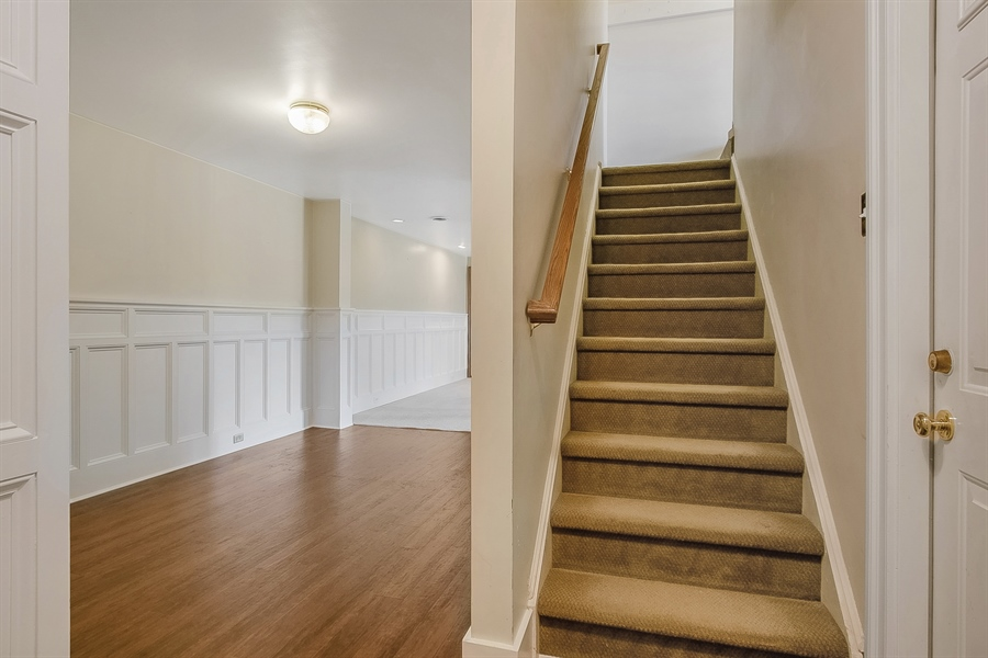Real Estate Photography - 5 Grosbeak Ln, Newark, DE, 19711 - Stairway To The Finished Walk-Out Lower Level