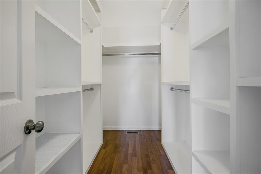 Real Estate Photography - 5 Grosbeak Ln, Newark, DE, 19711 - Walk-In Master Bedroom Closet With Organizers
