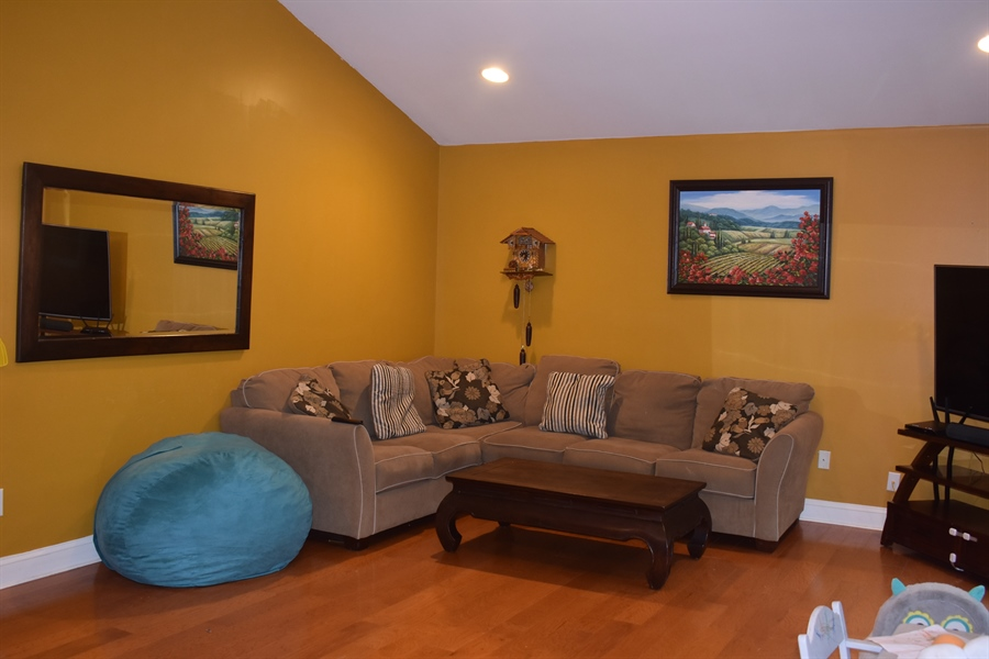 Real Estate Photography - 196 Mifflin Rd, Dover, DE, 19904 - Great room with vaulted ceiling