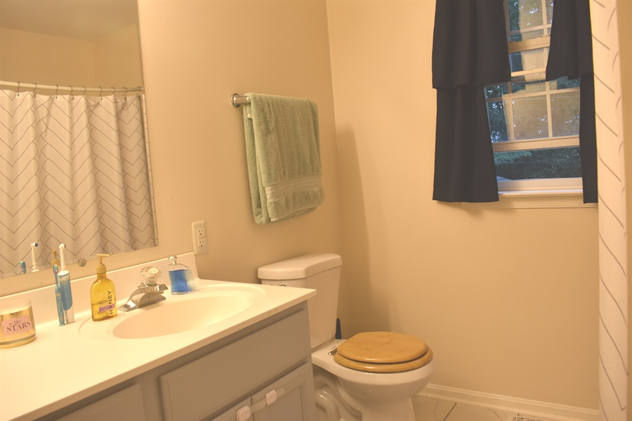 Real Estate Photography - 196 Mifflin Rd, Dover, DE, 19904 - Master bath with double vanity