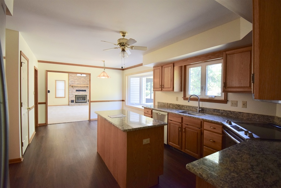 Real Estate Photography - 513 Penn Manor Dr, Newark, DE, 19711 - Eat In kitchen looking into Family Room