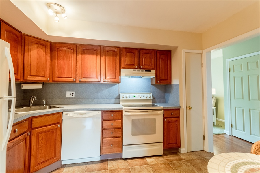 Real Estate Photography - 10 West Ct, Wilmington, DE, 19810 - Updated kitchen boasts ample oak cabinetry