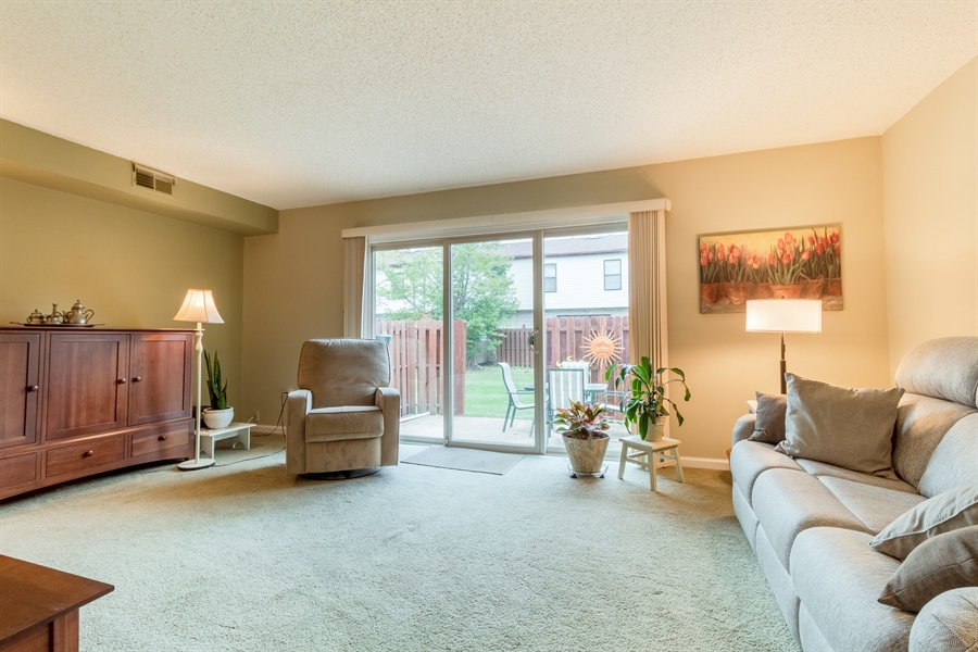Real Estate Photography - 10 West Ct, Wilmington, DE, 19810 - Spacious living room with sliders to back patio