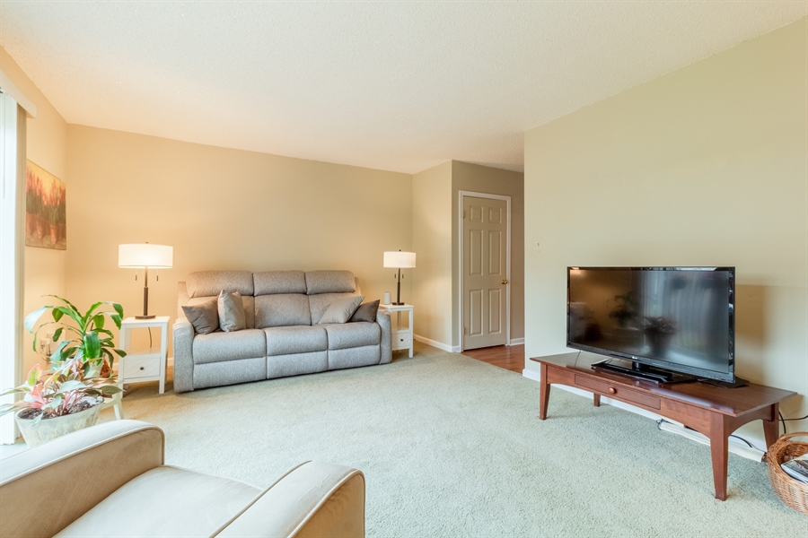 Real Estate Photography - 10 West Ct, Wilmington, DE, 19810 - Bright living room with neutral carpeting