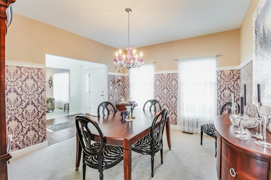 Real Estate Photography - 915 Benalli Dr, Middletown, DE, 19709 - Formal dining room to the right as you enter