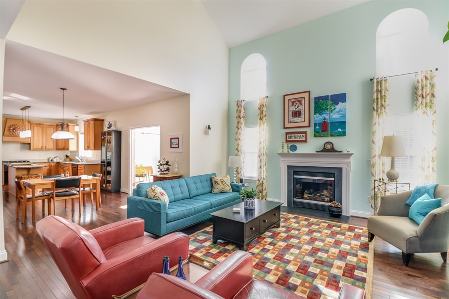 Real Estate Photography - 915 Benalli Dr, Middletown, DE, 19709 - Maple hardwood floors and gas fireplace