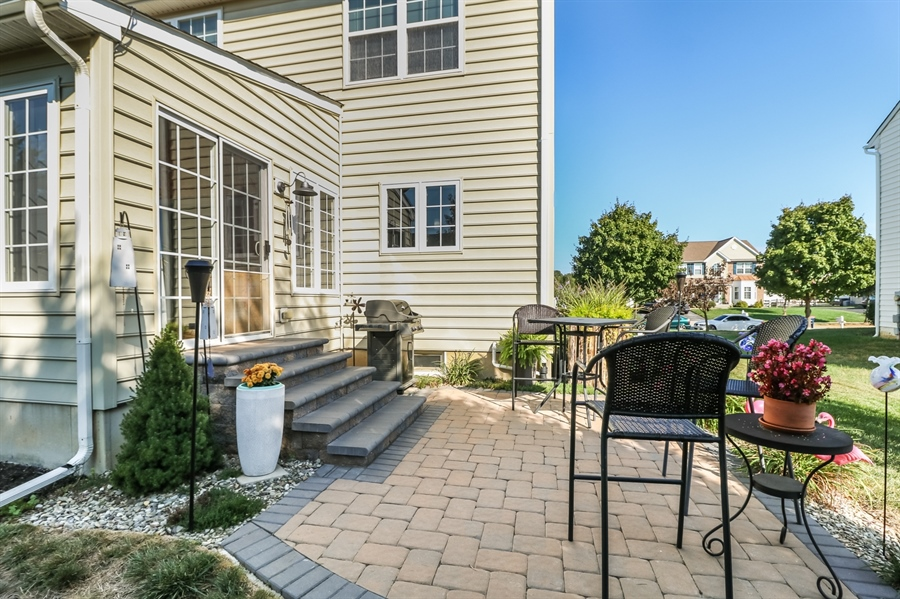 Real Estate Photography - 915 Benalli Dr, Middletown, DE, 19709 - backyard paver patio for outdoor entertaining