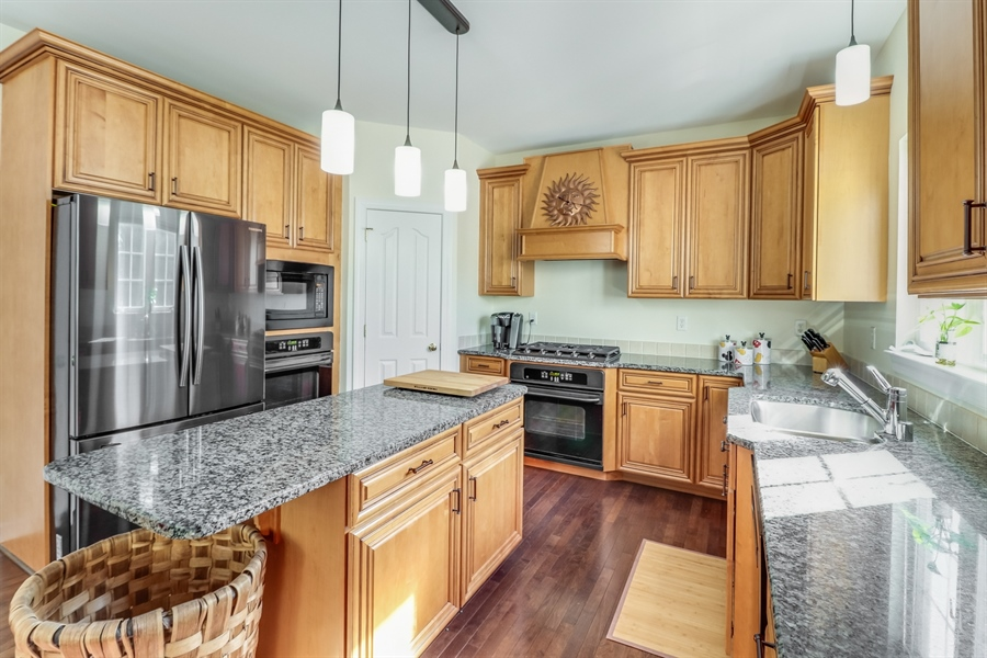 Real Estate Photography - 915 Benalli Dr, Middletown, DE, 19709 - Corner pantry and gas cooktop