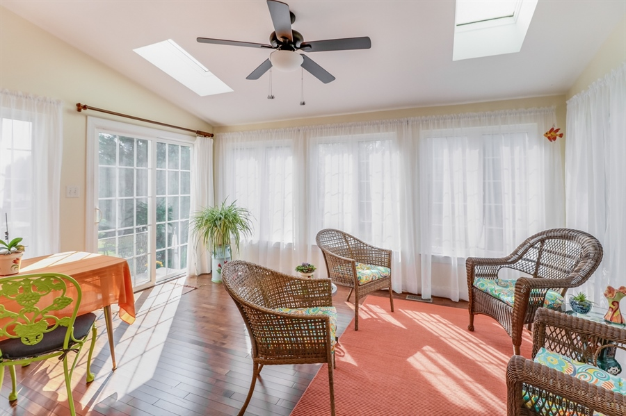 Real Estate Photography - 915 Benalli Dr, Middletown, DE, 19709 - Sunroom with vaulted ceiling and skylights