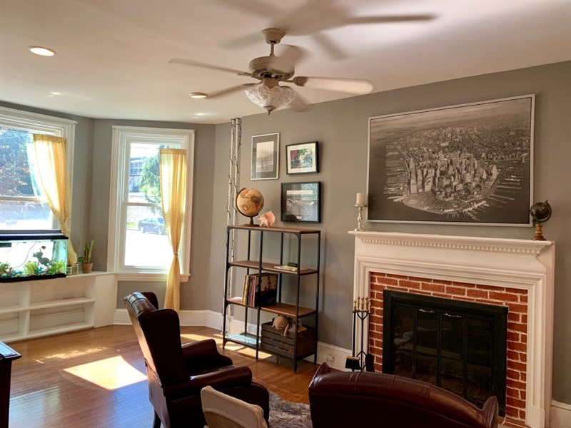 Real Estate Photography - 1701 N Rodney St, Wilmington, DE, 19806 - Living Room w Fireplace and bumpout window