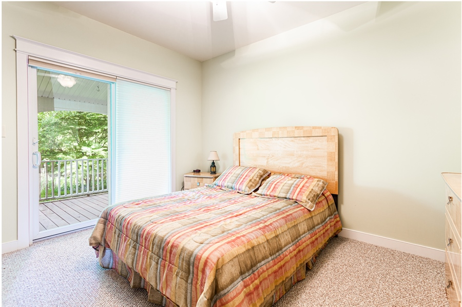 Real Estate Photography - 302 Cecil Avenue, Earleville, DE, 21919 - main level bedroom with porch access