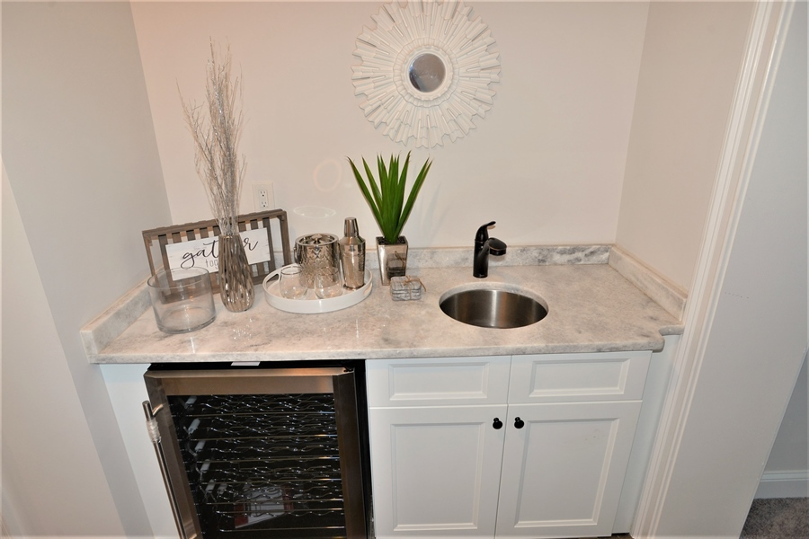 Real Estate Photography - 1426 E Strasburg Rd, West Chester, PA, 19380 - Wet Bar w/Wine Fridge in Great Room.