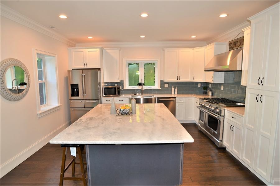 Real Estate Photography - 1426 E Strasburg Rd, West Chester, PA, 19380 - Kitchen w/Quarts, Prof. Stove & Hood.
