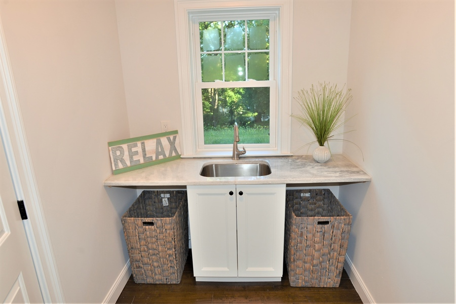 Real Estate Photography - 1426 E Strasburg Rd, West Chester, PA, 19380 - Large Laundry w/Sink and Plenty of Room.