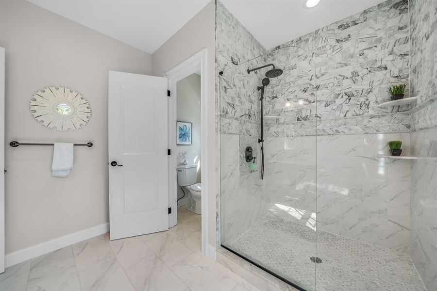 Real Estate Photography - 1426 E Strasburg Rd, West Chester, PA, 19380 - Lots of Custom Tile Work.