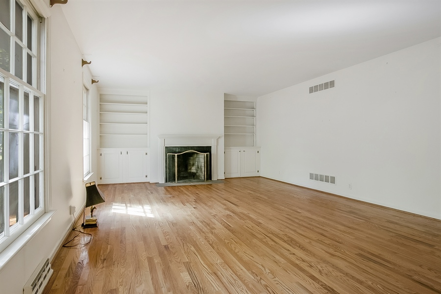Real Estate Photography - 3303 Coachman Rd, Wilmington, DE, 19803 - Built-In Surrounded Fireplace in Living Room