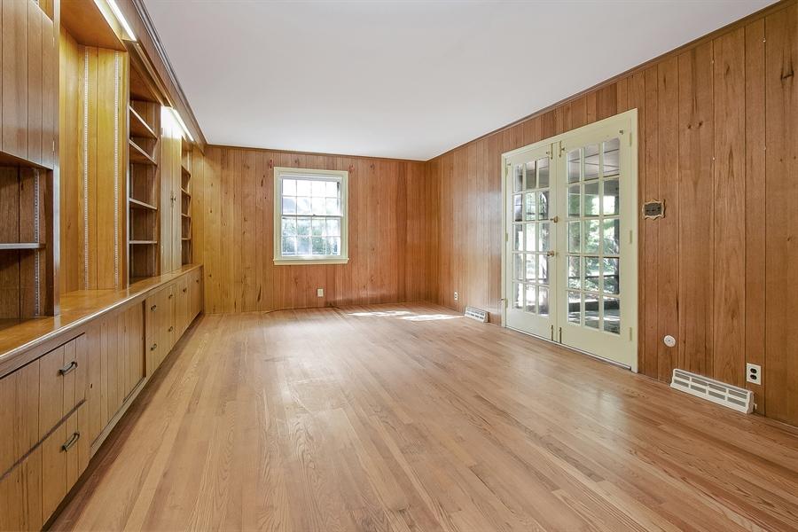 Real Estate Photography - 3303 Coachman Rd, Wilmington, DE, 19803 - Family Room w/ Built-Ins & Enclosed Porch Access
