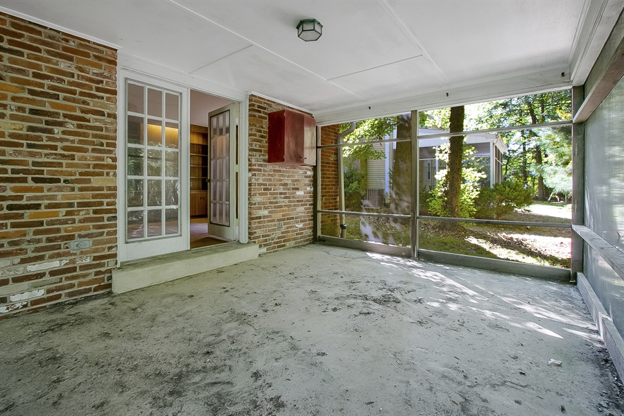 Real Estate Photography - 3303 Coachman Rd, Wilmington, DE, 19803 - Family Room Accessible From Enclosed Porch