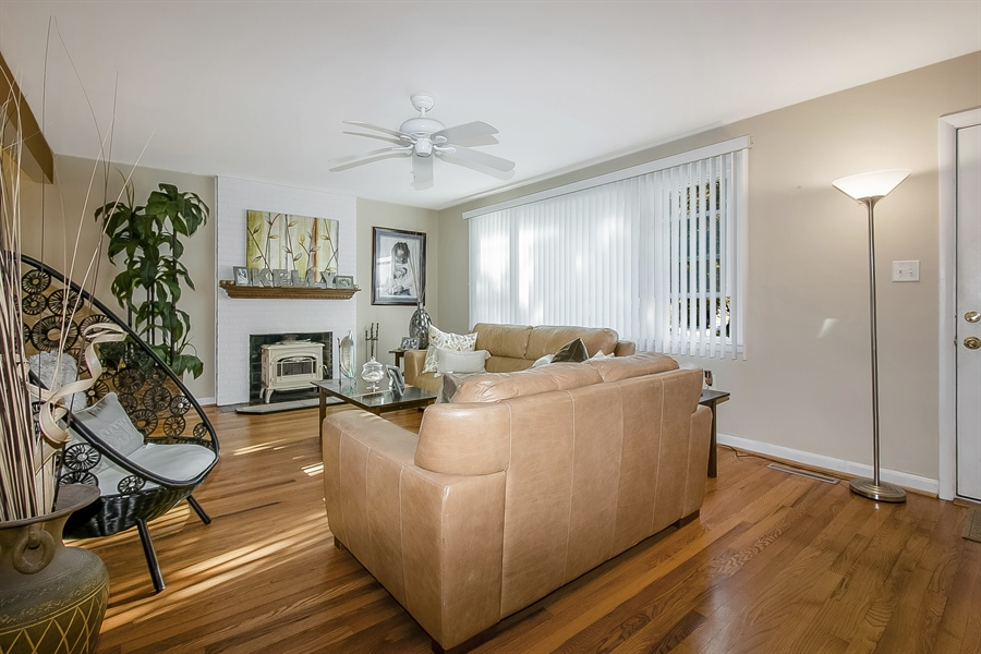 Real Estate Photography - 1113 Wilson Rd, Wilmington, DE, 19803 - Bright LR with tons of natural sunlight