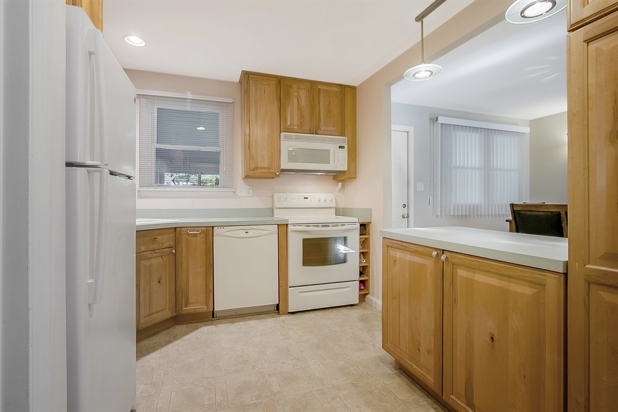 """Real Estate Photography - 1113 Wilson Rd, Wilmington, DE, 19803 - Kitchen with 42"""" maple cabinets."""