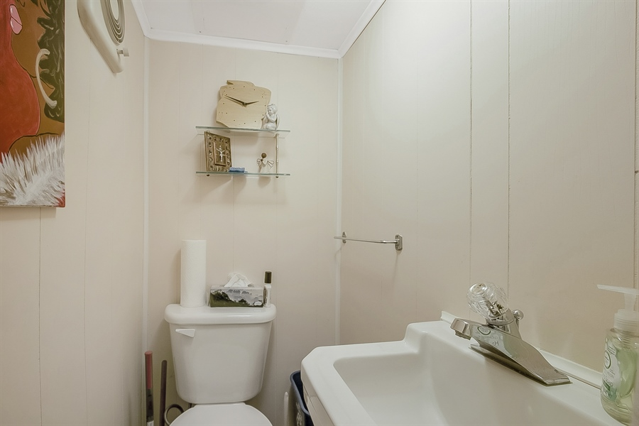 Real Estate Photography - 1113 Wilson Rd, Wilmington, DE, 19803 - Powder Room off family room