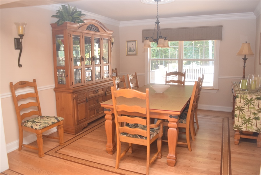 Real Estate Photography - 109 Nashua Ct, Bear, DE, 19701 - Dinning room with Crown Molding and Hardwood