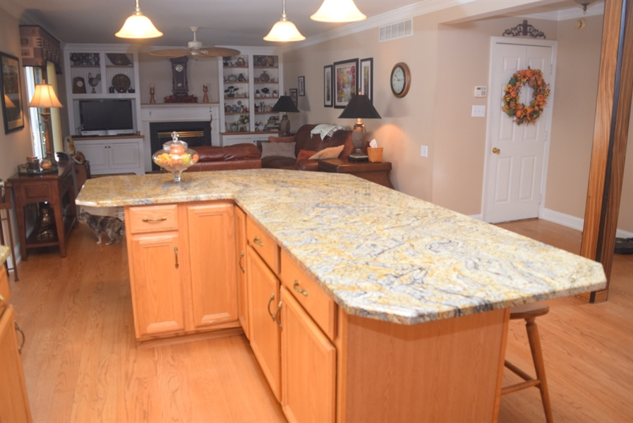 Real Estate Photography - 109 Nashua Ct, Bear, DE, 19701 - Expanded Kitchen Island with Beautiful Granite top
