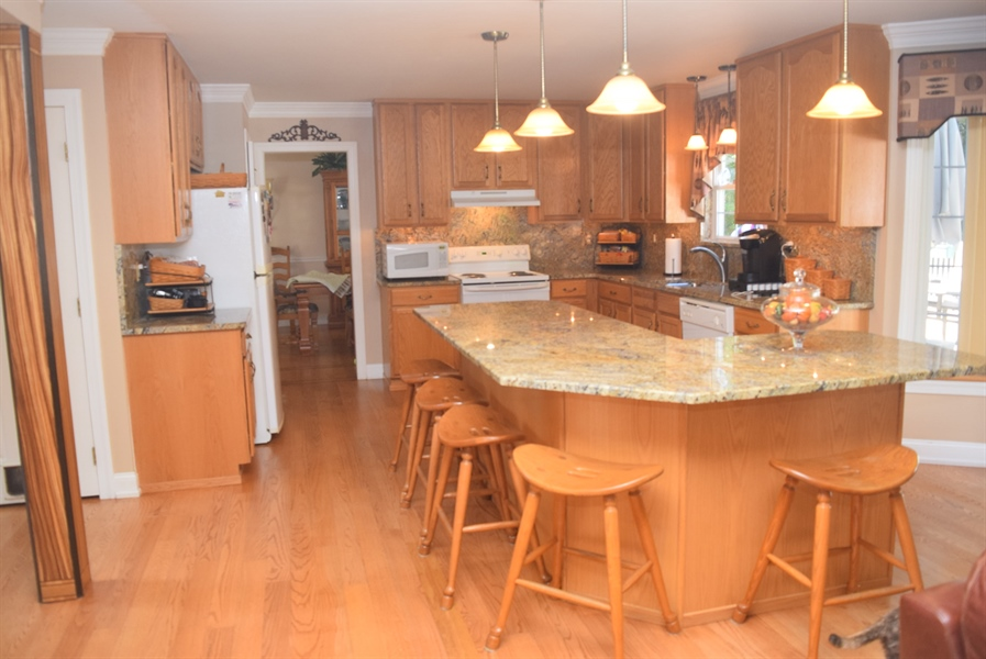 Real Estate Photography - 109 Nashua Ct, Bear, DE, 19701 - Kitchen Island seats 5-6, Upgraded Lighting