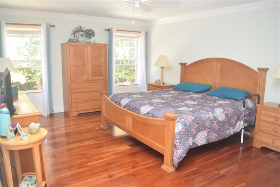 Real Estate Photography - 109 Nashua Ct, Bear, DE, 19701 - Large Master Bedroom with Cherry Wood flooring