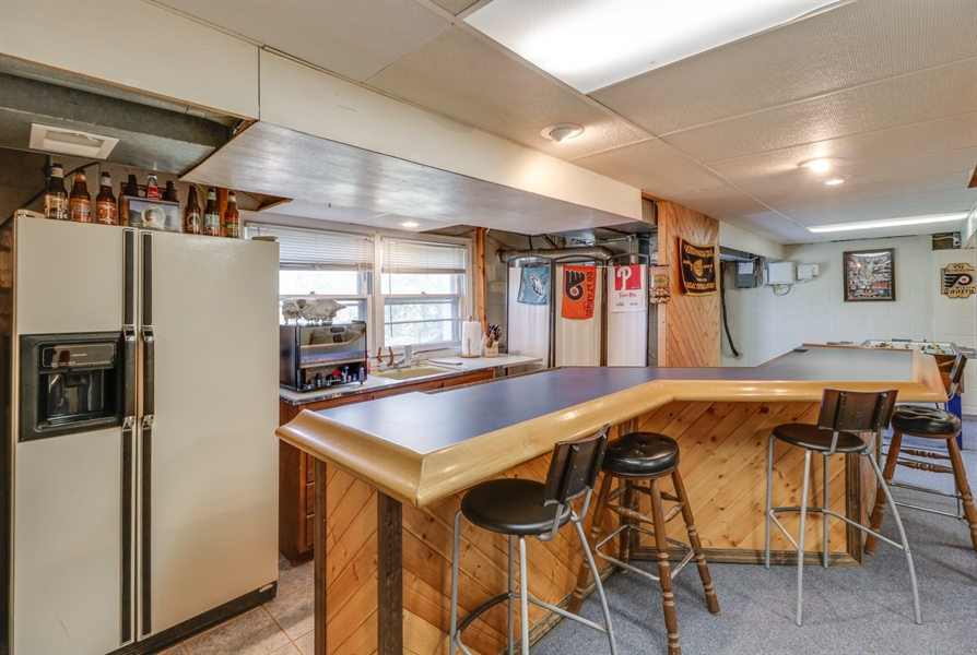 Real Estate Photography - 16 Yellow Pine Ct, Wilmington, DE, 19808 - Basement/Bar area